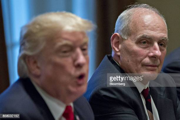 John Kelly White House chief of staff right listens as US President Donald Trump speaks during a briefing with senior military leaders in the Cabinet...