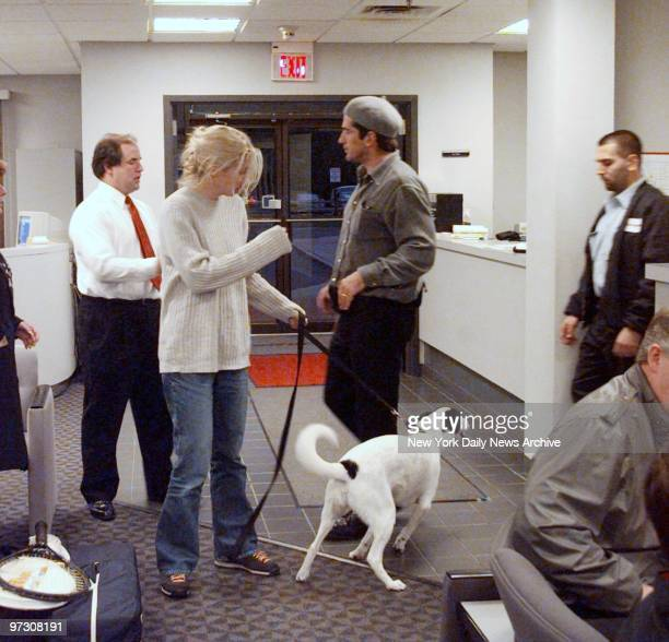 John Kennedy Jr and wife Carolyn Bessette Kennedy with dog at Teterboro Airport