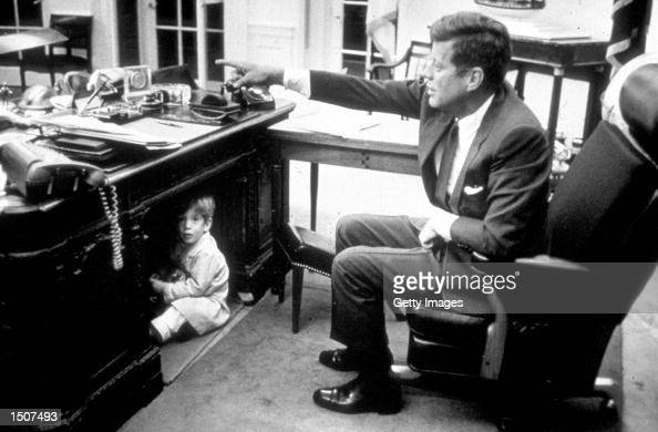 John Kennedy Jr playing in the Oval Office at the White House Washington DC October 15 1963