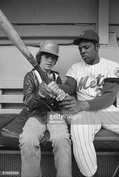 John Kennedy Jr the son of the late President is shown here as he gets some batting advice from an undisputed authority on the subject Willie Mays
