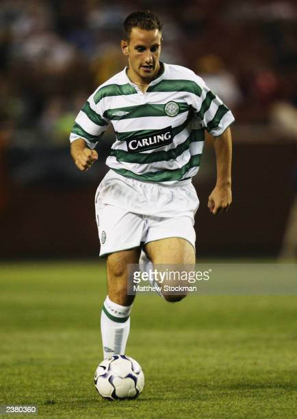 John Kennedy of Celtic charges forward during the PreSeason Friendly match between Glasgow Celtic and Boca Juniors held on July 25 2003 at the...