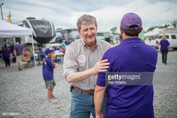 John Kennedy Republican candidate for the US Senate from Louisiana greets fans at a tailgate before the football game between the Louisiana State...