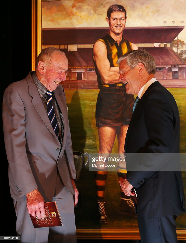 John Kennedy Snr (L) and David Parkin stand in front of his portrait after being inducted as a legend during the Hawthorn Hawks Season Launch and Hall of Fame presentation at Encore St Kilda on March 21, 2013 in Melbourne, Australia.
