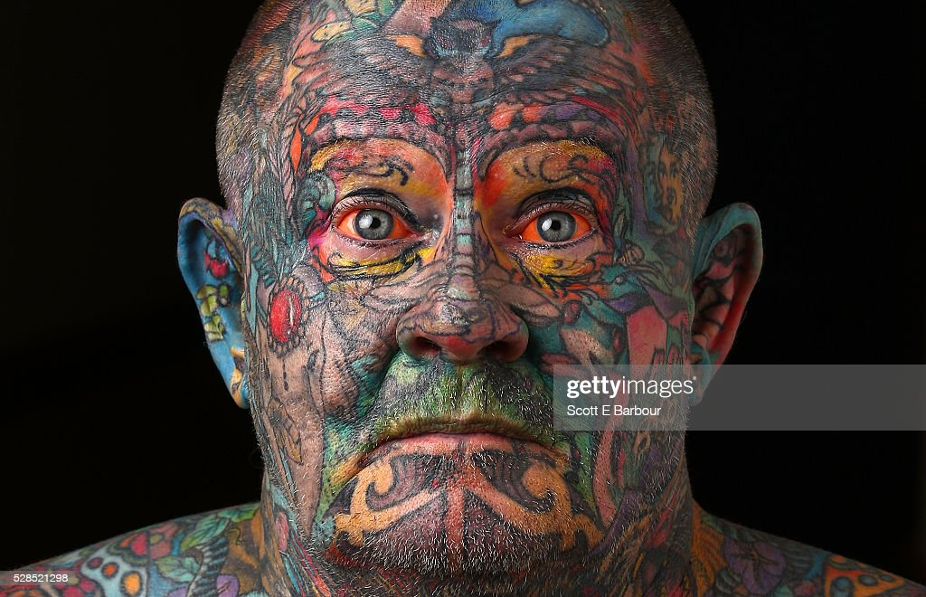 John Kenney poses for a portrait in his home on April 28, 2016 in Melbourne, Australia. The 60 year old has tattoos all over his body, including his eyelids and eyeballs. His fascination with tattoos started when he was 18, and led to him contracting Hepatitis C from a dirty needle. He even hacked a finger off with a meat cleaver during a part-time job to claim compensation money. After a life of crime on the streets and drug addiction, John Kenney now speaks to school children about the perils of drug abuse and tattoos and is an advocate for the homeless.