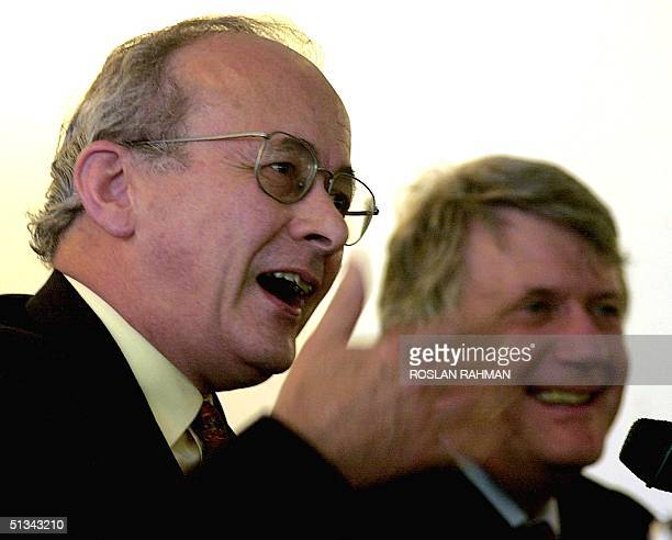 John Kerr UK's most senior diplomat and chief foreign policy adviser to the British Foreign Secretary gestures as he answers question from reporters...