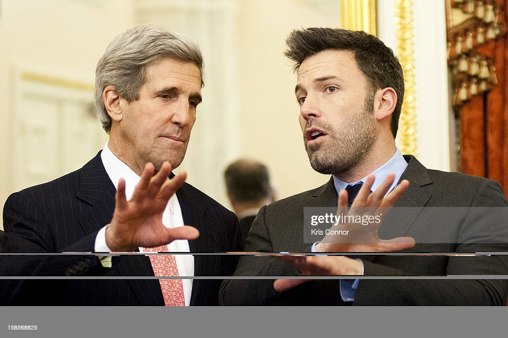 <a gi-track='captionPersonalityLinkClicked' href=/galleries/search?phrase=John+Kerry&family=editorial&specificpeople=154885 ng-click='$event.stopPropagation()'>John Kerry</a> and <a gi-track='captionPersonalityLinkClicked' href=/galleries/search?phrase=Ben+Affleck&family=editorial&specificpeople=201856 ng-click='$event.stopPropagation()'>Ben Affleck</a> pose for a photo during a meeting with members of the Senate Foreign Relations Committee in the U.S. Capitol on December 19, 2012 in Washington, DC.
