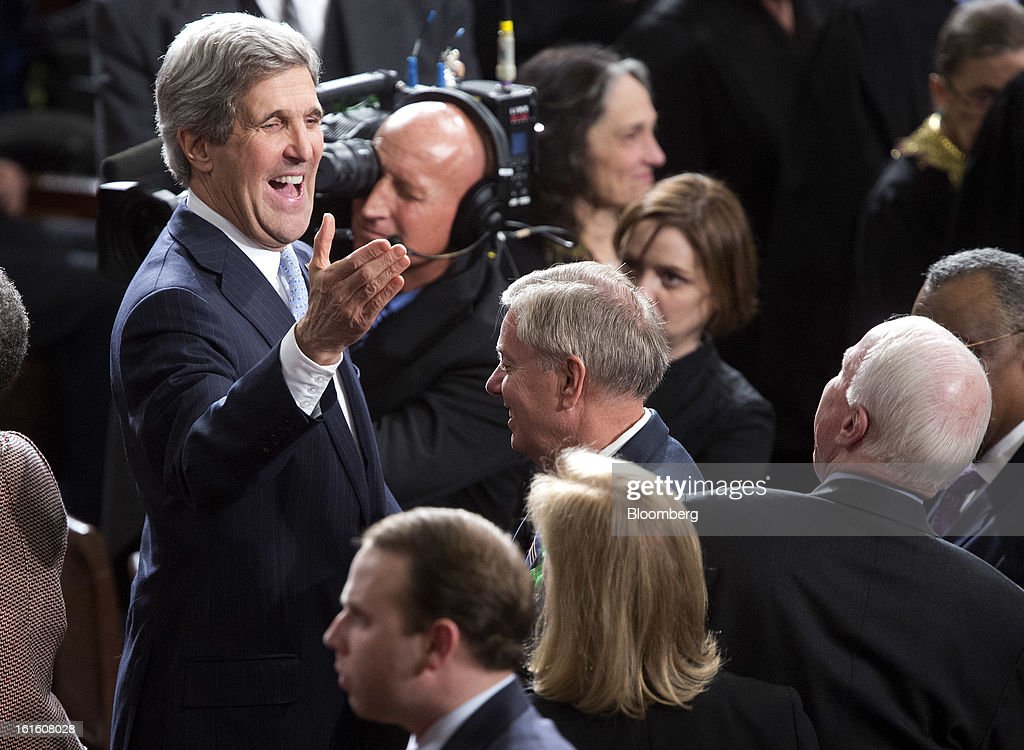 John Kerry, U.S. secretary of state, left, greets Senator Lindsey Graham, a Republican from South Carolina, center and Senator John McCain, a Republican from Arizona, right, before U.S. President Barack Obama's State of the Union address to a joint session of Congress at the Capitol in Washington, D.C., U.S., on Tuesday, Feb. 12, 2013. Obama called for raising the federal minimum wage to $9 an hour and warned he'll use executive powers to get his way on issues from climate change to manufacturing if Congress doesn't act, laying out an assertive second-term agenda sure to provoke Republicans. Photographer: Joshua Roberts/Bloomberg via Getty Images