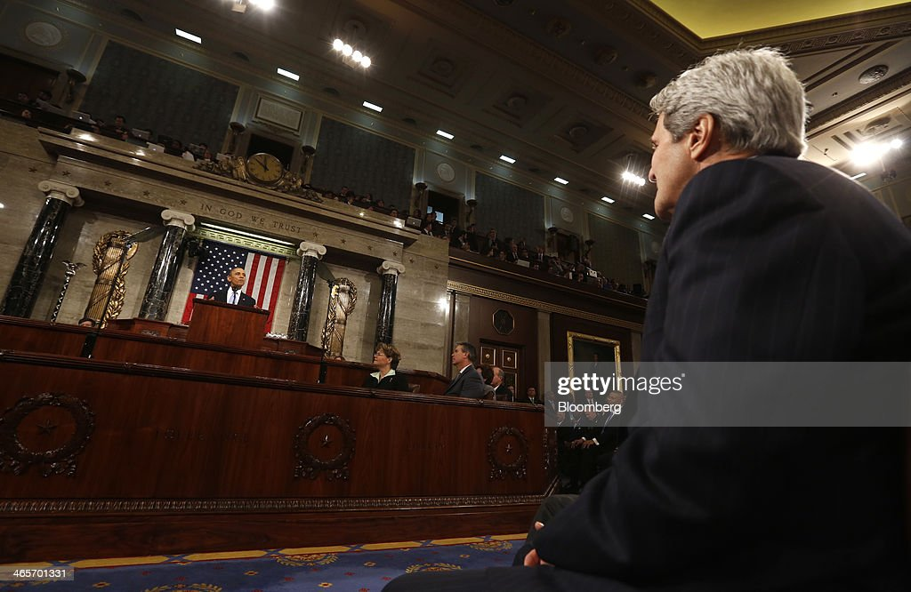 John Kerry, U.S. secretary of state, right, listens as U.S. President Barack Obama, left, delivers the State of the Union address to a joint session of Congress at the Capitol in Washington, D.C., U.S., on Tuesday, Jan. 28, 2014. Obama offered modest steps to chip away at the country's economic and social challenges in a State of the Union address that reflects the limits of his power to sway Congress. Photographer: Larry Downing/Pool via Bloomberg