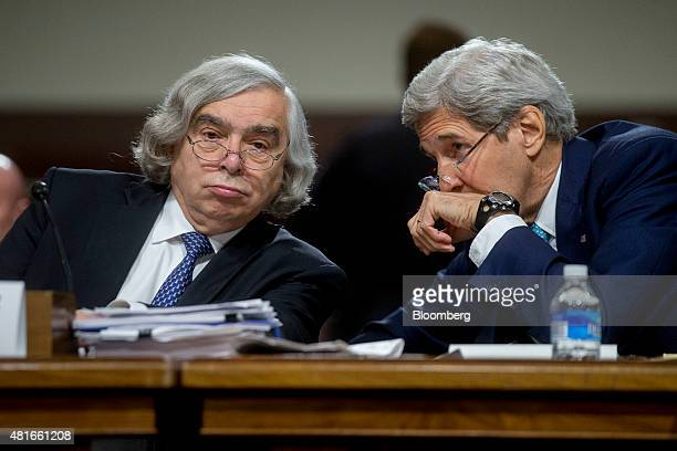 John Kerry US secretary of state right talks to Ernest Moniz US secretary of energy during a Senate Foreign Relations Committee hearing in Washington...