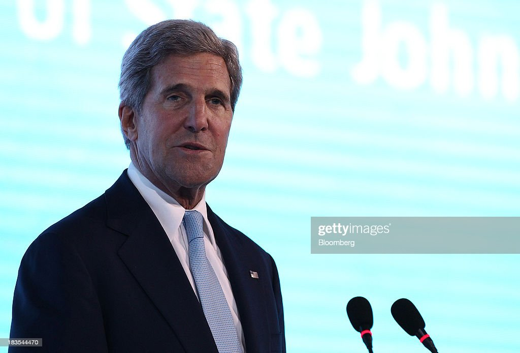 <a gi-track='captionPersonalityLinkClicked' href=/galleries/search?phrase=John+Kerry&family=editorial&specificpeople=154885 ng-click='$event.stopPropagation()'>John Kerry</a>, U.S. secretary of state, speaks at the Asia-Pacific Economic Cooperation (APEC) CEO Summit in Nusa Dua, Bali, Indonesia, on Monday, Oct. 7, 2013. Kerry commended Syrian leader Bashar al-Assad for starting to destroy his chemical weapons, and said the U.S. and Russia are pushing to convene a peace conference next month to end to the war. Photographer: SeongJoon Cho/Bloomberg via Getty Images