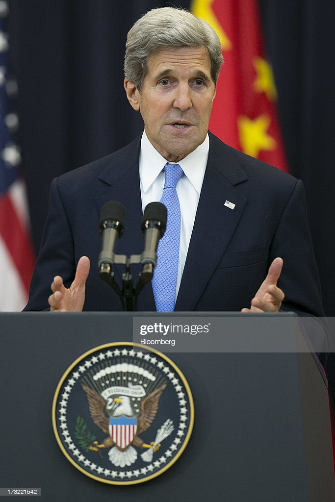 <a gi-track='captionPersonalityLinkClicked' href=/galleries/search?phrase=John+Kerry&family=editorial&specificpeople=154885 ng-click='$event.stopPropagation()'>John Kerry</a>, U.S. secretary of state, speaks during the opening session of the U.S.-China Strategic and Economic Dialogue (S&ED) conference at the State Department in Washington, D.C., U.S., on Wednesday, July 10, 2013. The U.S. and China are meeting this week to find ways to balance a wider flow of investment and goods as their central banks try to prevent excessive risk-taking from derailing the world's biggest economies. Photographer: Andrew Harrer/Bloomberg via Getty Images