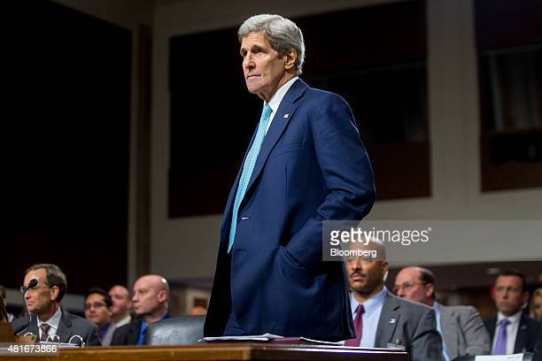 John Kerry US secretary of state stands up during a Senate Foreign Relations Committee hearing in Washington DC US on Thursday July 23 2015 Senator...