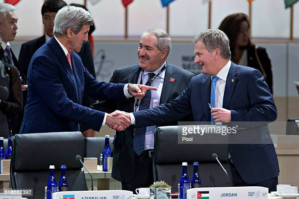 John Kerry US Secretary of State talks to Sauli Niinisto Finland's president and Nasser Judeh Jordan's minister of foreign affairs during a closing...