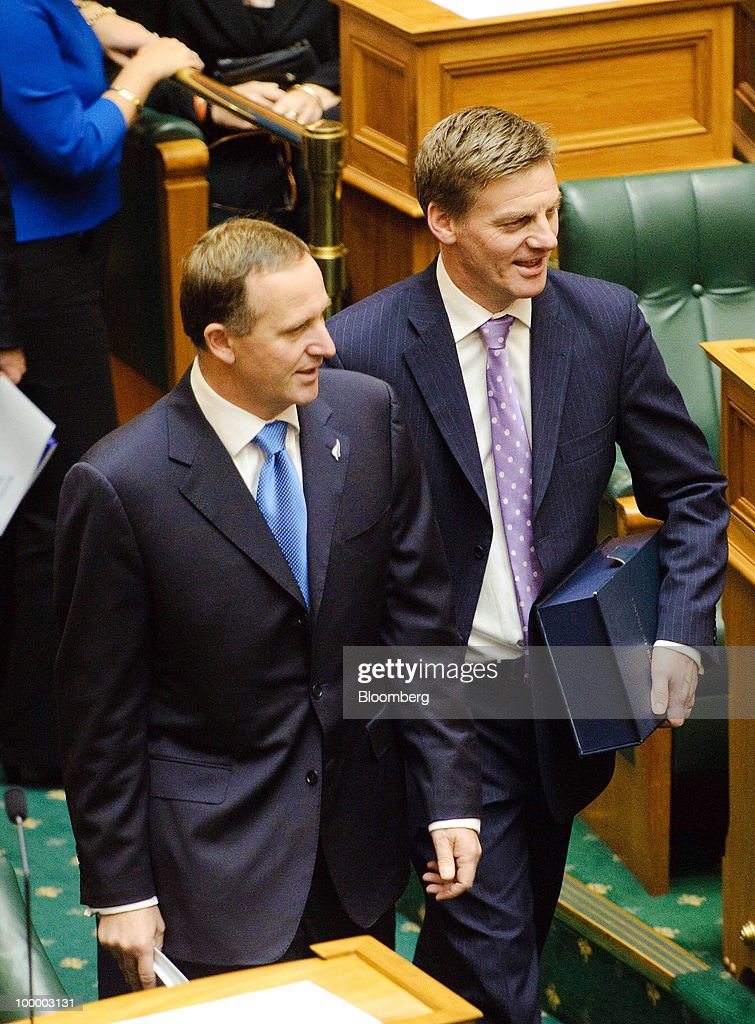 John Key, New Zealand's prime minister, left, and Bill English, New Zealand's finance minister, enter the House in Parliament for the reading of the budget, in Wellington, New Zealand, on Thursday, May 20, 2009. New Zealand will raise sales tax for the first time in two decades and lower income taxes to encourage household saving, aiming to reduce the economy's 'vulnerability' to concerns about sovereign debt. Photographer: Mark Coote/Bloomberg via Getty Images