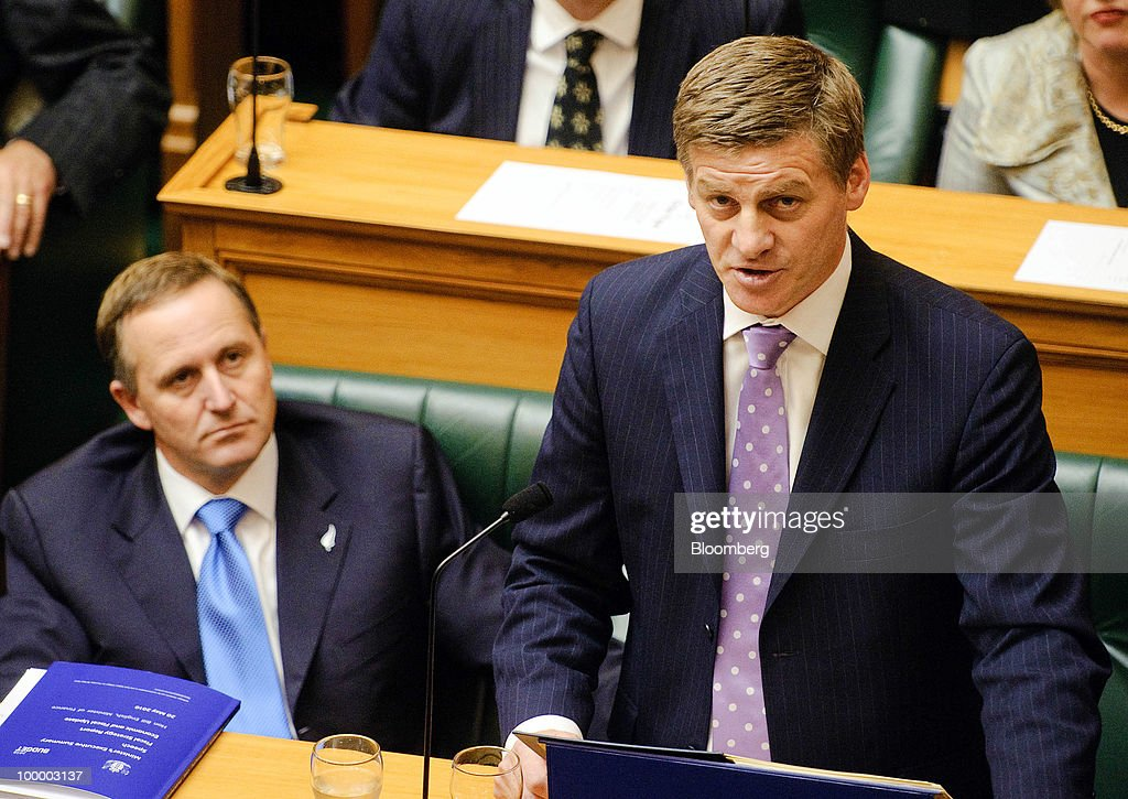 John Key, New Zealand's prime minister, left, listens as Bill English, New Zealand's finance minister, reads the budget in Parliament, in Wellington, New Zealand, on Thursday, May 20, 2009. New Zealand will raise sales tax for the first time in two decades and lower income taxes to encourage household saving, aiming to reduce the economy's 'vulnerability' to concerns about sovereign debt. Photographer: Mark Coote/Bloomberg via Getty Images