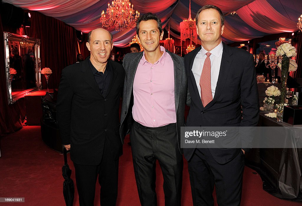 John Kilik, Erik Feig and Michael Burns attend Lionsgate's The Hunger Games: Catching Fire Cannes Party at Baoli Beach sponsored by COVERGIRL on May 18, 2013 in Cannes, France.