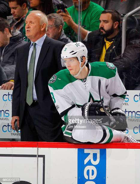 John Klingberg and head coach Lindy Ruff of the Dallas Stars look on against the New Jersey Devils on March 26 2017 at Prudential Center in Newark...