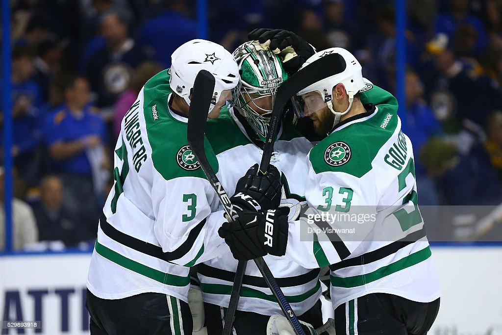 John Klingberg #3, Kari Lehtonen #32 and Kari Lehtonen #32 of the Dallas Stars celebrate after beating the St. Louis Blues in Game Six of the Western Conference Second Round during the 2016 NHL Stanley Cup Playoffs at the Scottrade Center on May 9, 2016 in St. Louis, Missouri.