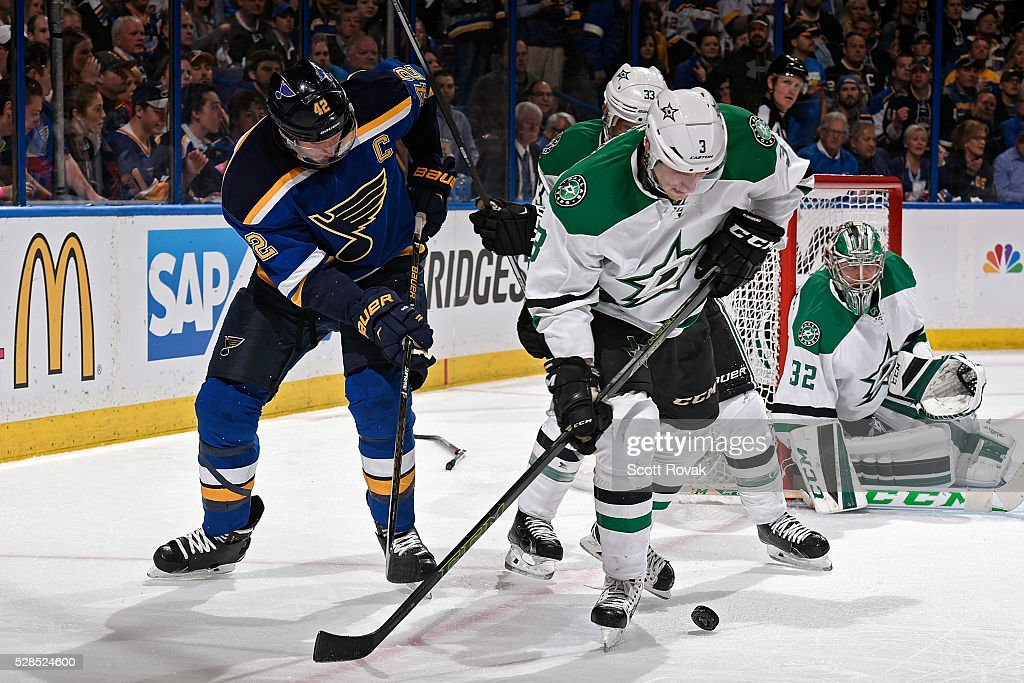 <a gi-track='captionPersonalityLinkClicked' href=/galleries/search?phrase=John+Klingberg&family=editorial&specificpeople=7418652 ng-click='$event.stopPropagation()'>John Klingberg</a> #3 of the Dallas Stars and <a gi-track='captionPersonalityLinkClicked' href=/galleries/search?phrase=David+Backes&family=editorial&specificpeople=2538492 ng-click='$event.stopPropagation()'>David Backes</a> #42 of the St. Louis Blues battle for the puck in Game Four of the Western Conference Second Round during the 2016 NHL Stanley Cup Playoffs at the Scottrade Center on May 5, 2016 in St. Louis, Missouri.
