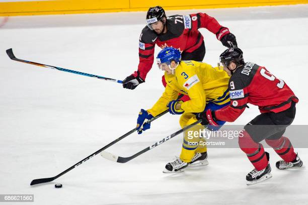 John Klingberg vies with Matt Duchene and Alex Killorn during the Ice Hockey World Championship Gold medal game between Canada and Sweden at Lanxess...