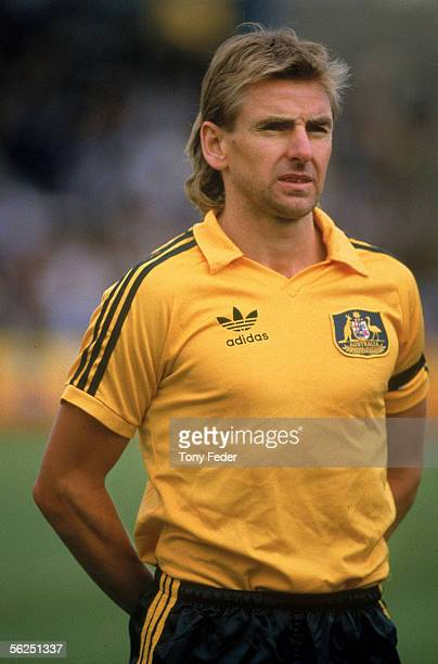 John Kosmina of the Socceroos looks on during the singing of the National Anthem before the start of a soccer match held at Olympic Park 1985 in...