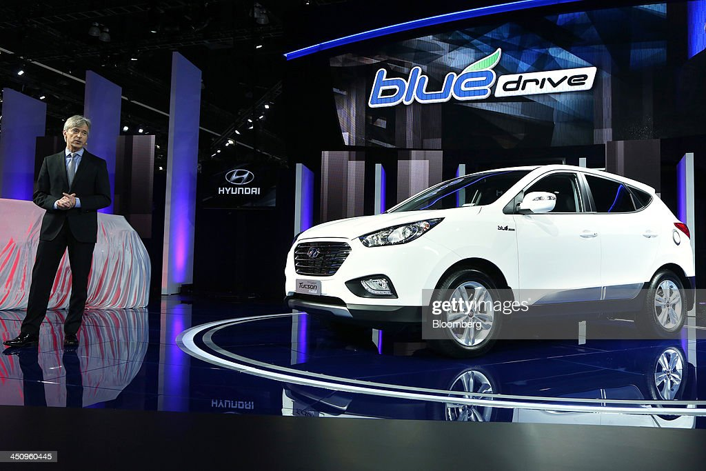 John Krafcik, chief executive officer and president of Hyundai Motor America, speaks next to the company's Hyundai Tucson Fuel Cell vehicle during the LA Auto Show in Los Angeles, California, U.S., on Wednesday, Nov. 20, 2013. The 2013 LA Auto Show is open to the public Nov. 22 - Dec. 1. Photographer: Jonathan Alcorn/Bloomberg via Getty Images
