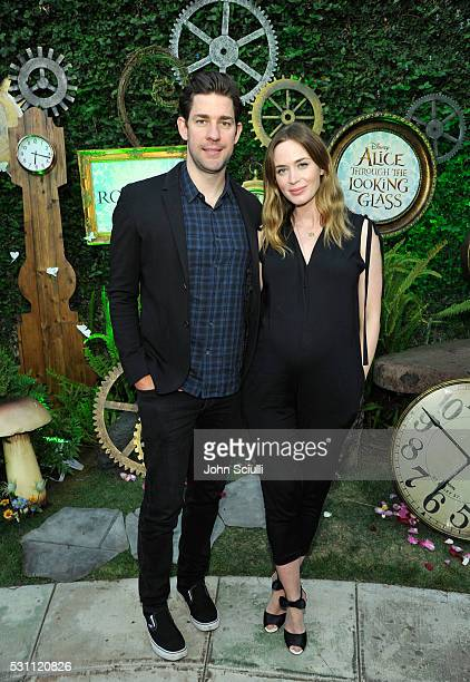 John Krasinski and Emily Blunt attend Disney's Alice Through the Looking Glass event on May 12 2016 at Roseark in Los Angeles California Top...