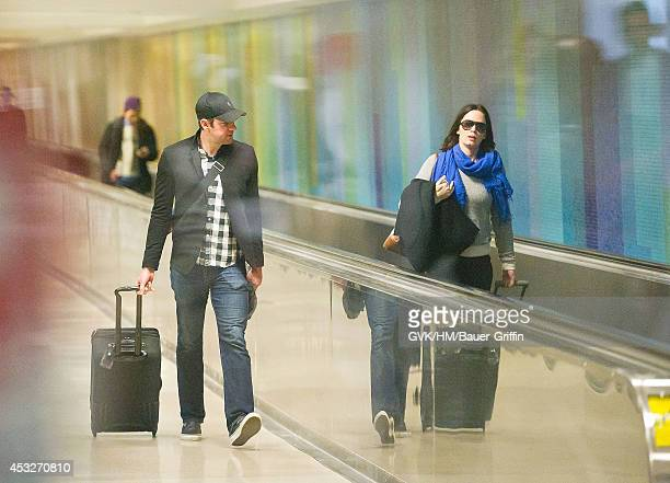 John Krasinski and girlfriend Emily Blunt are seen at Los Angeles International Airport on February 11 2012 in Los Angeles California