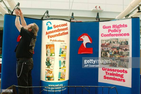 John Krull of the Second Amendment Foundation readies his organizations booth before the 133rd Annual NRA Convention at the David L Lawrence...