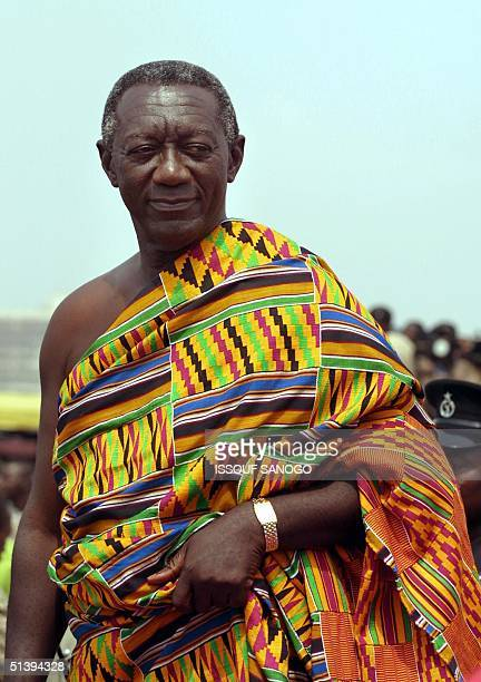 John Kufuor new Ghana's President is draped in traditional Kente cloth before the swearing ceremony in Accra 07 January 2001 Ghana's longtime ruler...