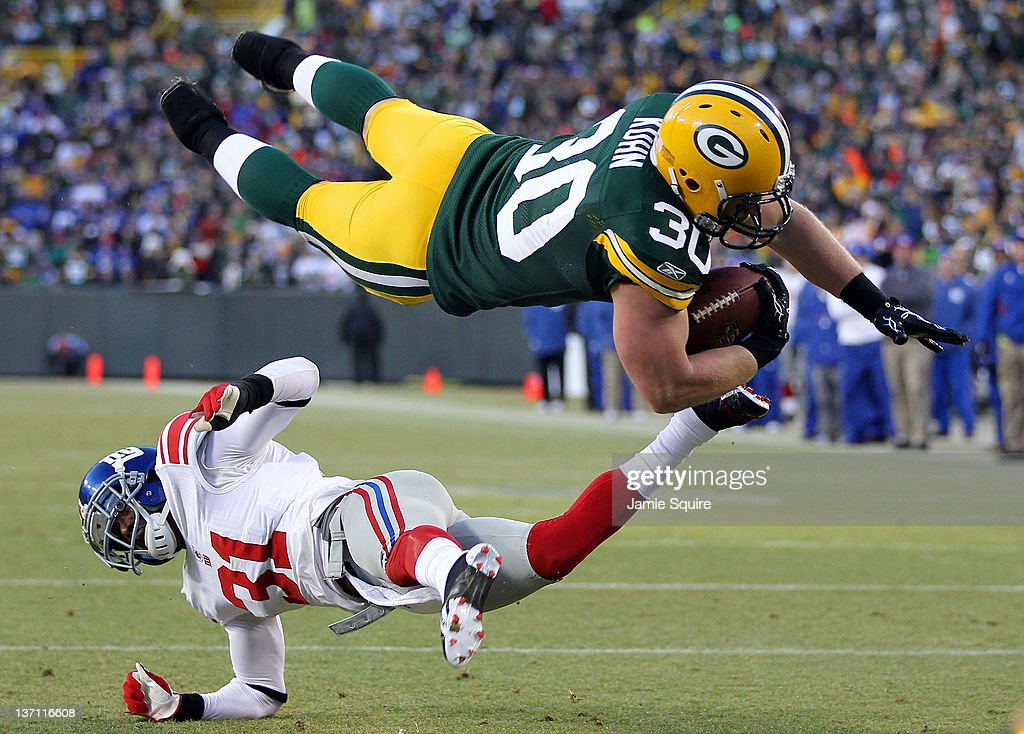 John Kuhn #30 of the Green Bay Packers dives in for the touchdown over <a gi-track='captionPersonalityLinkClicked' href=/galleries/search?phrase=Aaron+Ross+-+American+Football+Cornerback&family=editorial&specificpeople=2105852 ng-click='$event.stopPropagation()'>Aaron Ross</a> #31 of the New York Giants during their NFC Divisional playoff game at Lambeau Field on January 15, 2012 in Green Bay, Wisconsin.