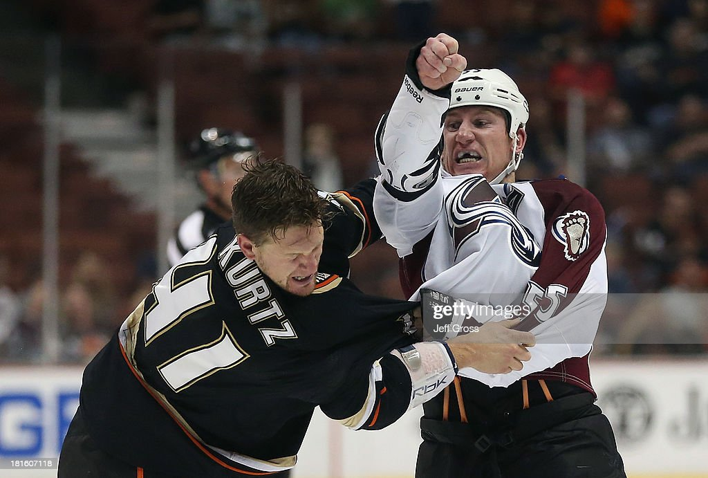 John Kurtz #41 of the Anaheim Ducks and <a gi-track='captionPersonalityLinkClicked' href=/galleries/search?phrase=Cody+McLeod&family=editorial&specificpeople=2242985 ng-click='$event.stopPropagation()'>Cody McLeod</a> #55 of the Colorado Avalanche fight in the first period at Honda Center on September 22, 2013 in Anaheim, California.