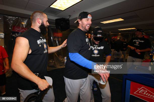 John Lackey and Jake Arrieta of the Chicago Cubs celebrate in the clubhouse after winning Game 5 of the National League Division Series 98 against...