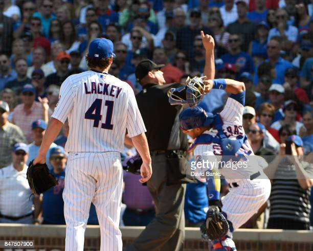 John Lackey and Willson Contreras of the Chicago Cubs are thrown out of the game for arguing a call with home plate umpire Jordan Baker during the...
