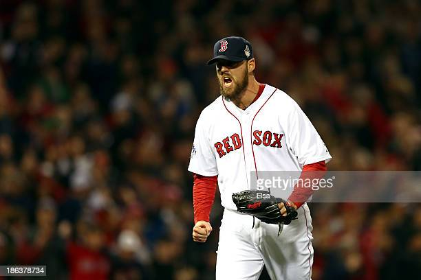 John Lackey of the Boston Red Sox celebrates a strikeout in the fourth inning against the St Louis Cardinals during Game Six of the 2013 World Series...