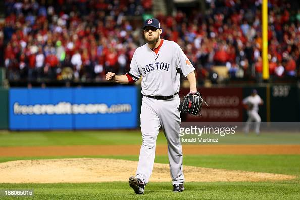 John Lackey of the Boston Red Sox celebrates closing out the eighth inning against David Freese of the St Louis Cardinals during Game Four of the...