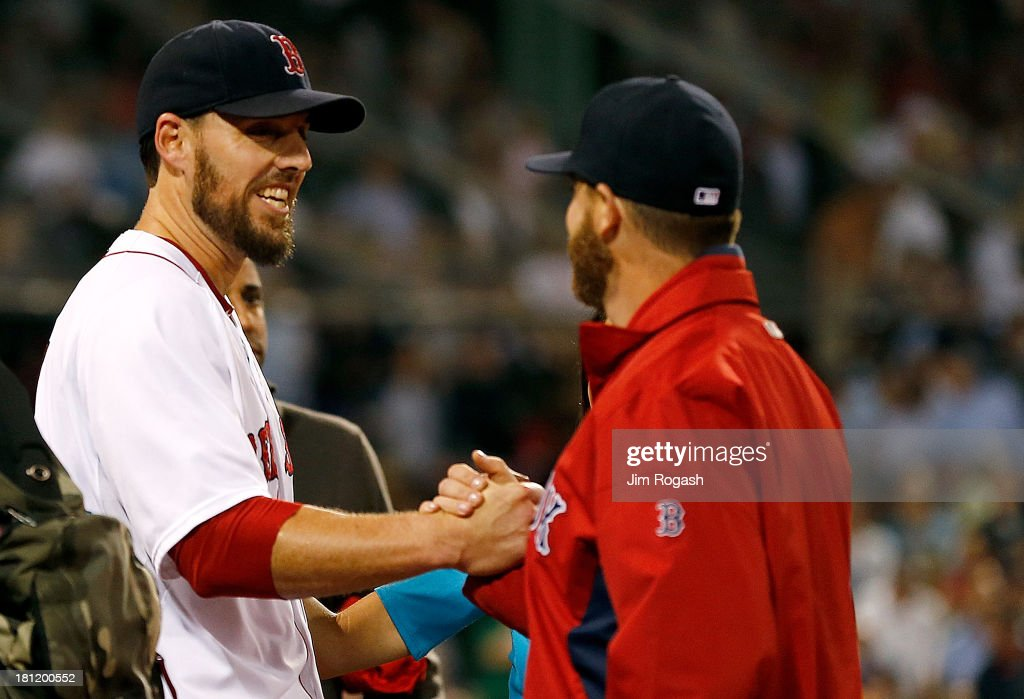 <a gi-track='captionPersonalityLinkClicked' href=/galleries/search?phrase=John+Lackey&family=editorial&specificpeople=171533 ng-click='$event.stopPropagation()'>John Lackey</a> #41 of the Boston Red Sox celebrates with a teammate after pitching a two-hit complete game against the Baltimore Orioles to clinch a playoff position at Fenway Park on September 19, 2013 in Boston, Massachusetts.