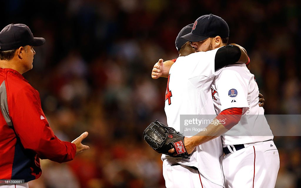 <a gi-track='captionPersonalityLinkClicked' href=/galleries/search?phrase=John+Lackey&family=editorial&specificpeople=171533 ng-click='$event.stopPropagation()'>John Lackey</a> #41 of the Boston Red Sox celebrates with <a gi-track='captionPersonalityLinkClicked' href=/galleries/search?phrase=David+Ortiz&family=editorial&specificpeople=175825 ng-click='$event.stopPropagation()'>David Ortiz</a> #34 after pitching a two-hit complete game against the Baltimore Orioles to clinch a playoff position at Fenway Park on September 19, 2013 in Boston, Massachusetts.