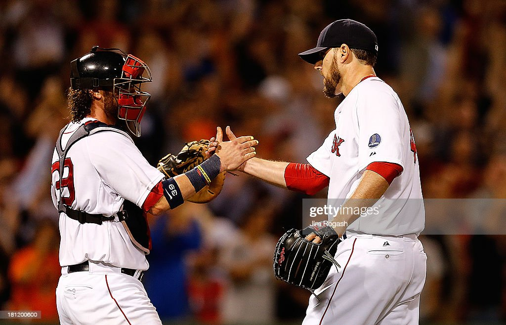 <a gi-track='captionPersonalityLinkClicked' href=/galleries/search?phrase=John+Lackey&family=editorial&specificpeople=171533 ng-click='$event.stopPropagation()'>John Lackey</a> #41 of the Boston Red Sox celebrates with <a gi-track='captionPersonalityLinkClicked' href=/galleries/search?phrase=Jarrod+Saltalamacchia&family=editorial&specificpeople=836404 ng-click='$event.stopPropagation()'>Jarrod Saltalamacchia</a> #39 after pitching a two-hit complete game against the Baltimore Orioles to clinch a playoff position at Fenway Park on September 19, 2013 in Boston, Massachusetts.