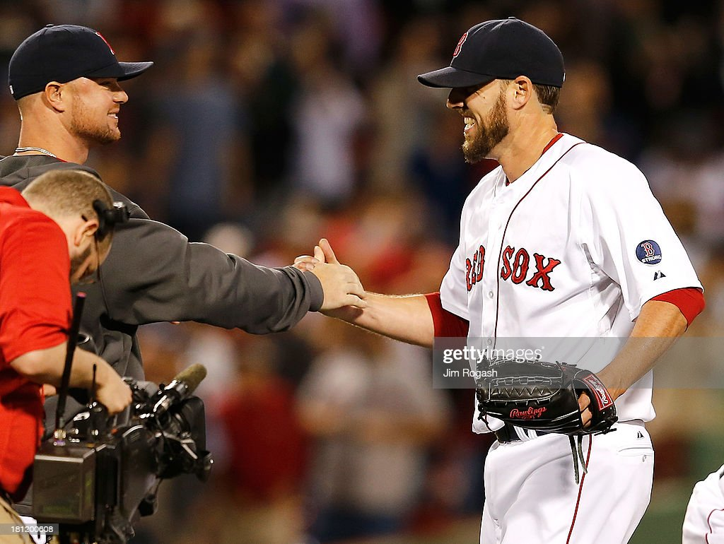 <a gi-track='captionPersonalityLinkClicked' href=/galleries/search?phrase=John+Lackey&family=editorial&specificpeople=171533 ng-click='$event.stopPropagation()'>John Lackey</a> #41 of the Boston Red Sox celebrates with <a gi-track='captionPersonalityLinkClicked' href=/galleries/search?phrase=Jon+Lester&family=editorial&specificpeople=832746 ng-click='$event.stopPropagation()'>Jon Lester</a> #31 of the Boston Red Sox after pitching a two-hit complete game against the Baltimore Orioles to clinch a playoff position at Fenway Park on September 19, 2013 in Boston, Massachusetts.