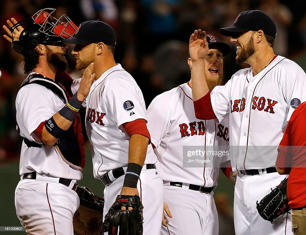 <a gi-track='captionPersonalityLinkClicked' href=/galleries/search?phrase=John+Lackey&family=editorial&specificpeople=171533 ng-click='$event.stopPropagation()'>John Lackey</a> #41 of the Boston Red Sox celebrates with teammates after pitching a two-hit complete game against the Baltimore Orioles to clinch a playoff position at Fenway Park on September 19, 2013 in Boston, Massachusetts.