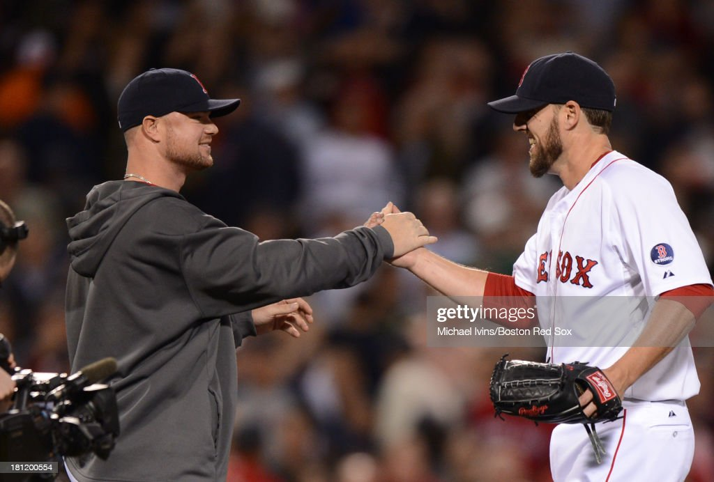 <a gi-track='captionPersonalityLinkClicked' href=/galleries/search?phrase=John+Lackey&family=editorial&specificpeople=171533 ng-click='$event.stopPropagation()'>John Lackey</a> #41 of the Boston Red Sox is congratulated by <a gi-track='captionPersonalityLinkClicked' href=/galleries/search?phrase=Jon+Lester&family=editorial&specificpeople=832746 ng-click='$event.stopPropagation()'>Jon Lester</a> #31 after pitching a complete game two-hitter against the Baltimore Orioles on September 19, 2013 in Boston, Massachusetts.