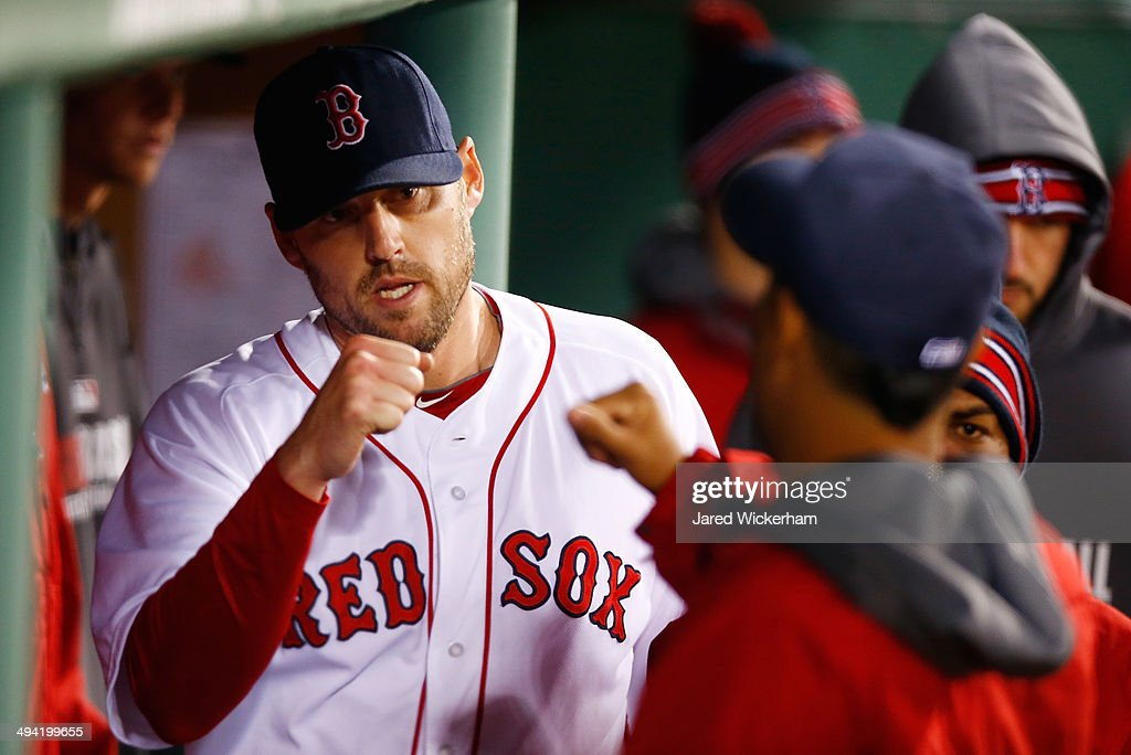 <a gi-track='captionPersonalityLinkClicked' href=/galleries/search?phrase=John+Lackey&family=editorial&specificpeople=171533 ng-click='$event.stopPropagation()'>John Lackey</a> #41 of the Boston Red Sox is congratulated by teammates in the dugout after being pulled from the game in the 7th inning by manager John Farrell #53 against the Atlanta Braves during the game at Fenway Park on May 28, 2014 in Boston, Massachusetts.