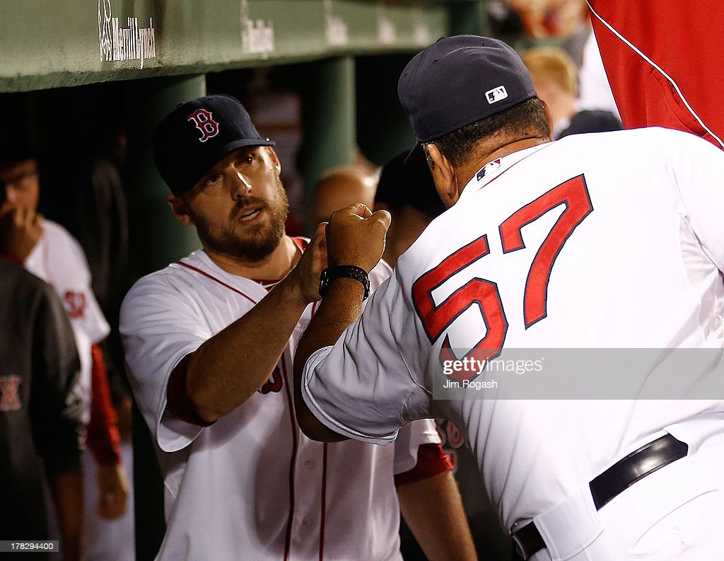 <a gi-track='captionPersonalityLinkClicked' href=/galleries/search?phrase=John+Lackey&family=editorial&specificpeople=171533 ng-click='$event.stopPropagation()'>John Lackey</a> #41 of the Boston Red Sox is greeted by teammates in the dugout after being relieved in the 8th inning against the Baltimore Orioles at Fenway Park on August 28, 2013 in Boston, Massachusetts.
