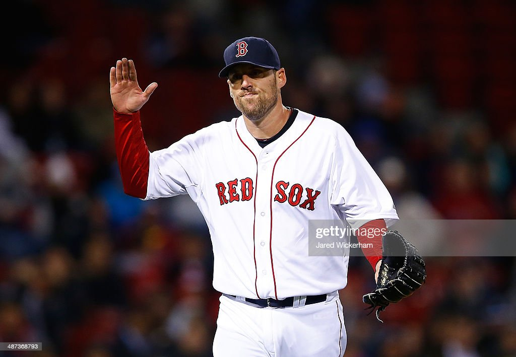 <a gi-track='captionPersonalityLinkClicked' href=/galleries/search?phrase=John+Lackey&family=editorial&specificpeople=171533 ng-click='$event.stopPropagation()'>John Lackey</a> #41 of the Boston Red Sox reacts after finishing off the 8th inning against the Tampa Bay Rays during the game at Fenway Park on April 29, 2014 in Boston, Massachusetts.