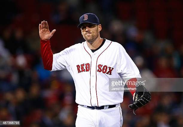 John Lackey of the Boston Red Sox reacts after finishing off the 8th inning against the Tampa Bay Rays during the game at Fenway Park on April 29...