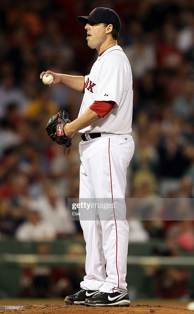<a gi-track='captionPersonalityLinkClicked' href=/galleries/search?phrase=John+Lackey&family=editorial&specificpeople=171533 ng-click='$event.stopPropagation()'>John Lackey</a> #41 of the Boston Red Sox reacts after Francisco Cervelli #17 of the New York Yankees hit a solo home run in the fifth inning on August 30, 2011 at Fenway Park in Boston, Massachusetts.