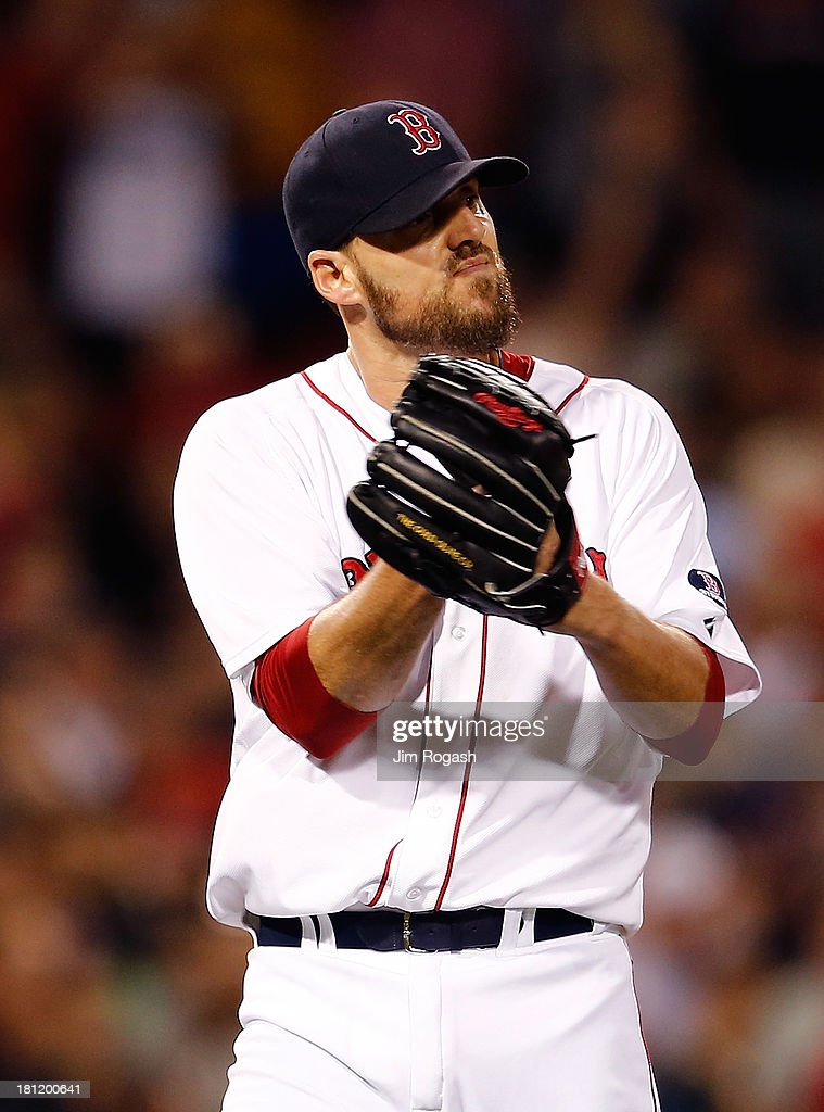 <a gi-track='captionPersonalityLinkClicked' href=/galleries/search?phrase=John+Lackey&family=editorial&specificpeople=171533 ng-click='$event.stopPropagation()'>John Lackey</a> #41 of the Boston Red Sox reacts after pitching a two-hit complete game against the Baltimore Orioles to clinch a playoff position at Fenway Park on September 19, 2013 in Boston, Massachusetts.