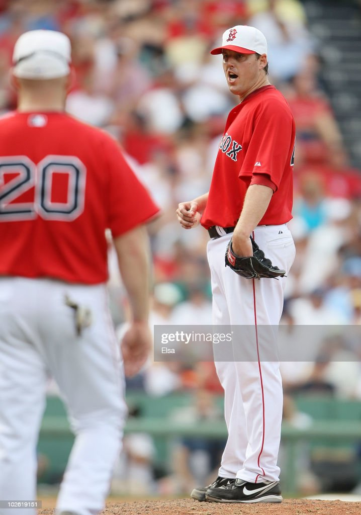 <a gi-track='captionPersonalityLinkClicked' href=/galleries/search?phrase=John+Lackey&family=editorial&specificpeople=171533 ng-click='$event.stopPropagation()'>John Lackey</a> #40 of the Boston Red Sox reacts as he is pulled from the game against the Baltimore Orioles on July 4, 2010 at Fenway Park in Boston, Massachusetts.