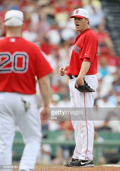 John Lackey of the Boston Red Sox reacts as he is pulled from the game against the Baltimore Orioles on July 4 2010 at Fenway Park in Boston...